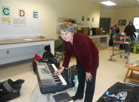 Karen checks out a keyboard for Sudan...