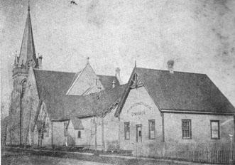 1900: Wesley-Knox, then Askin Street Methodist, from Teresa Street looking north. The original buildings had become a Sunday School and a gym.